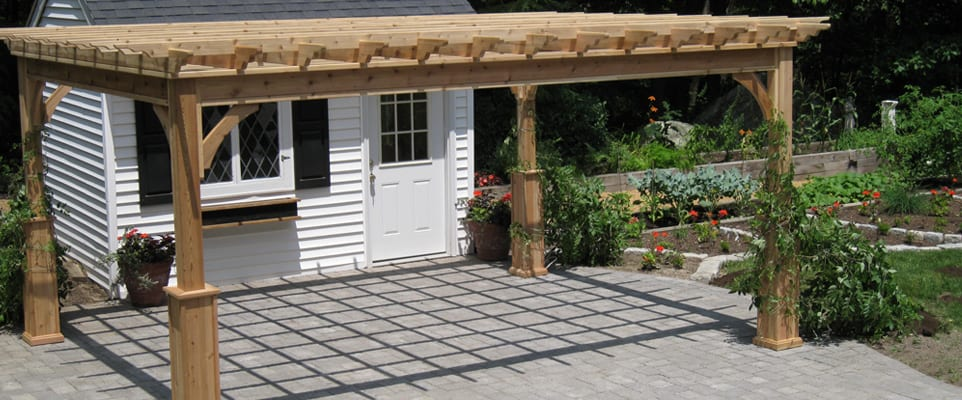 Paver patio with fire pit and cedar pergola